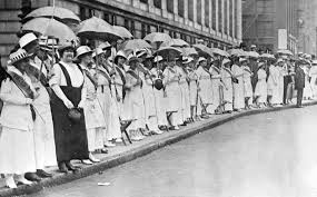 Suffragettes line the streets of St. Louis Missouri is a stare down of lawmakers. This event was called the Walkless, Talkless Parade.